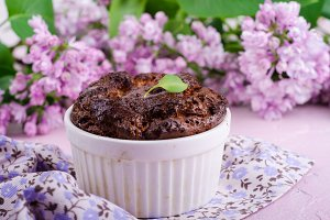 Homemade chocolate cheese souffle on pink background