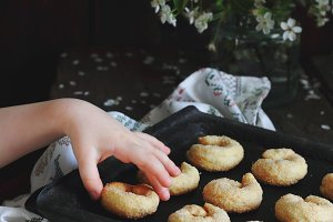 child takes homemade cookies
