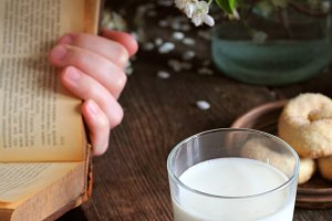 milk in a glass on a wooden table