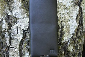 Brown Leather Mobile Case on wood