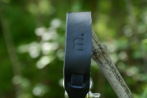 Black Leather Bracelet on a branch