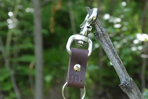 Brown Leather Key Clip on a branch