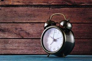 Alarm Clock at the Wooden Wall