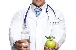 Young Doctor giving apple
