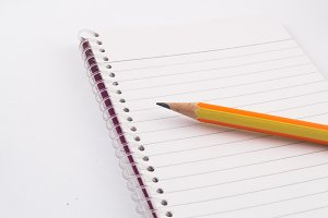 Pencil isolated on notebook