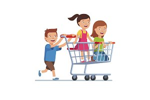 Boy and girls riding shopping cart