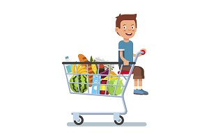 Kid sitting in a supermarket cart