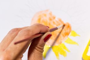 Woman hands painting