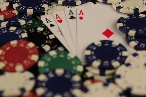 Ace focused in gambling coins