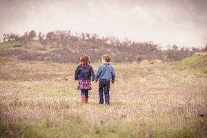 Children Walking in a Field