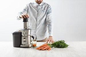 Man makes juice from carrot