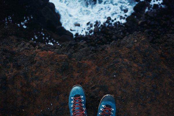 Man's feet walk outdoor in mountain…