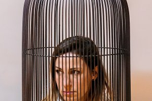 Woman inside cage
