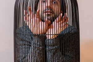 Man locked in a cage