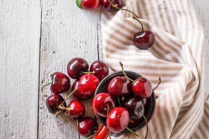 fresh cherries on wooden table