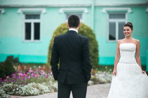 Beautiful wedding couple standing opposite each other