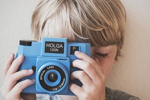 Boy with Film Camera
