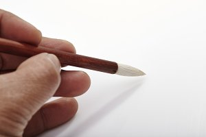 writing brush in man's hand