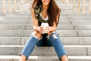 Beautiful girl with paper to go cup.