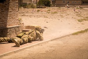 Soldier in action in conflict zone
