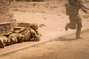 Soldiers in action in conflict zone