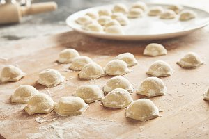 Woman cooks dumplings home