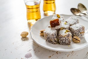Traditional turkish sweet lukum served with tea