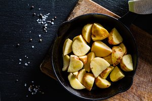 Raw potato slices with herbs, spices