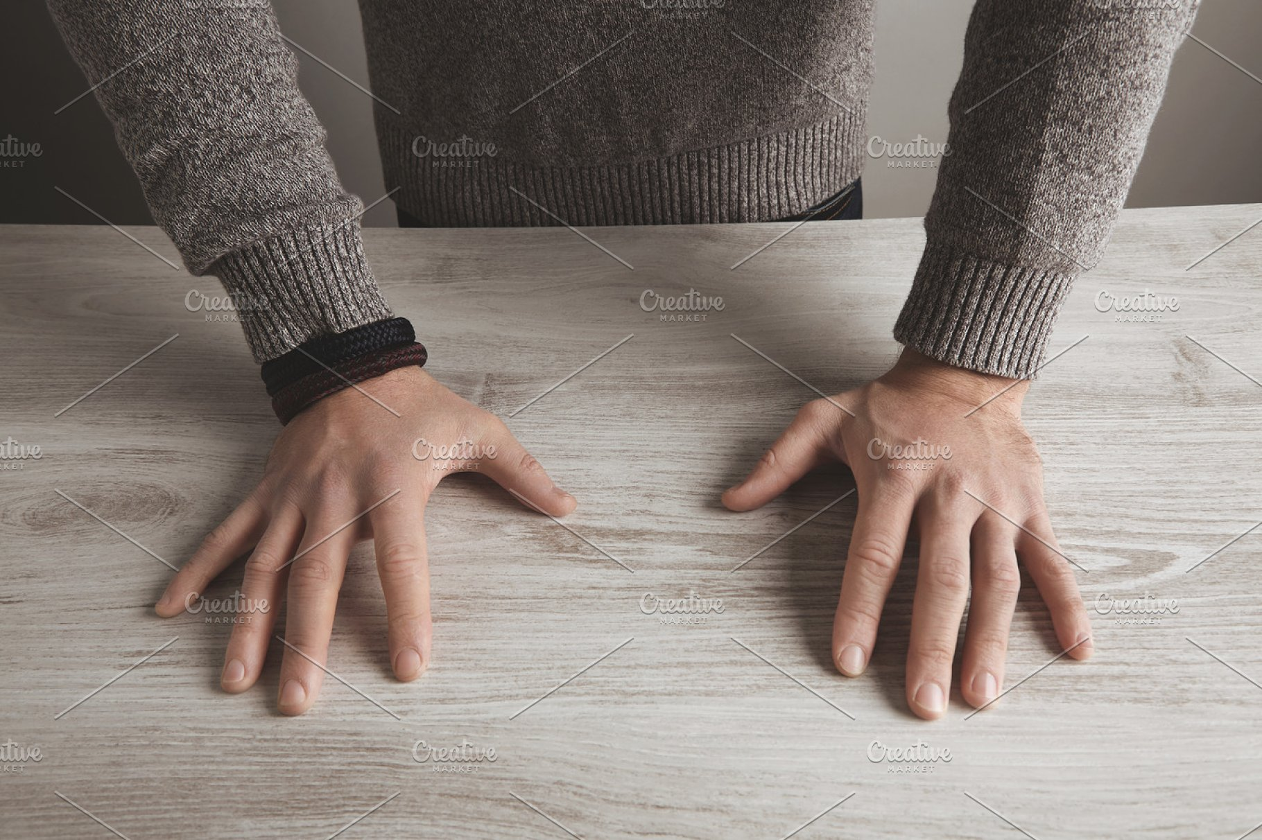 Man hands on table top view