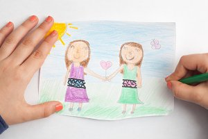 Little girl drawing friendship