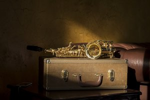 Saxophone on Suitcase