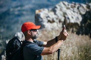 Mountaineer taking photo at mountain