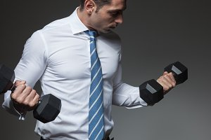 Businessman biceps curl
