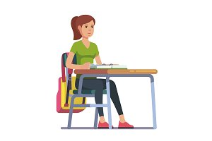 student sitting at her school desk
