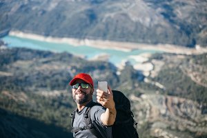 Smiling backpacker making selfie