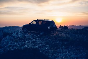 Car in the mountain against sunrise