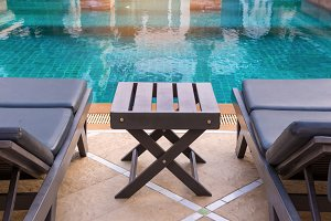 swimming pool with deckchairs