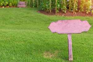wooden sign on grass.