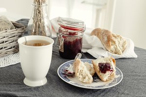 Strawberry marmalade, tea and bread