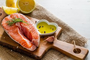 Salmon steak with lemon slices and spices