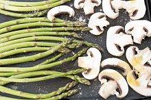 Raw mushrooms and asparagus