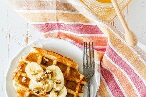 Waffles with banana and nuts honey