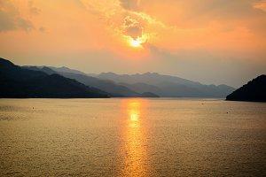 Sunset over mountain at lake