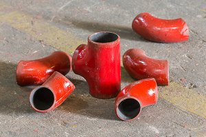Red color iron pipe joint