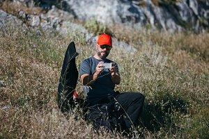 Hiker taking photo at mountain