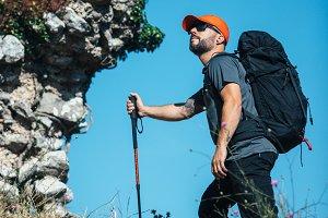 Climber holding climbing stick