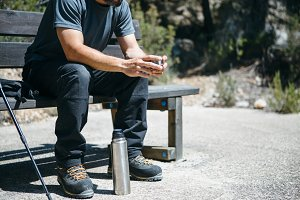 Traveler with flask on bench