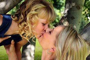 Mother Daughter Kiss in Tree