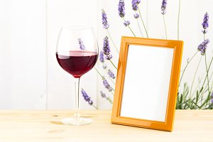 Glass of wine with lavender bush.