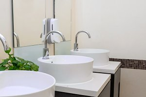 white basins in bathroom interior